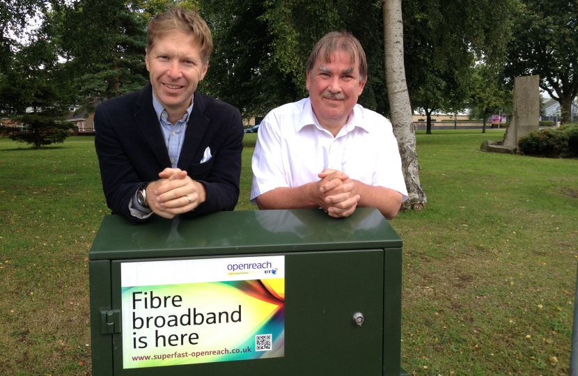 Cllrs' Ben Stokes and Steve Reade with broadband distribution cabinate